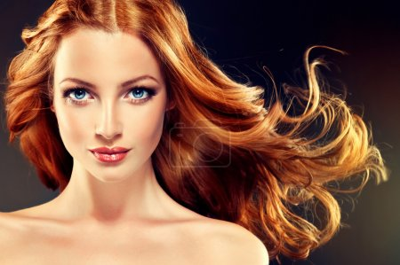 Photo for Beautiful model with long curly red hair.  Styling hairstyles curls - Royalty Free Image