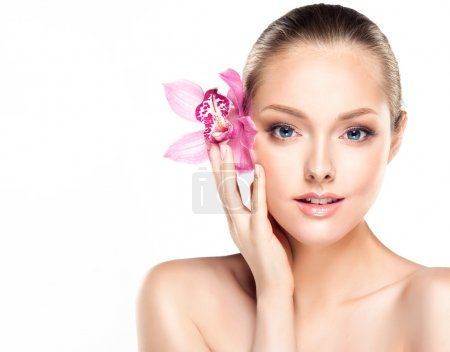 Spa Woman with orchid flower