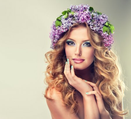 beautiful woman with lilac wreath