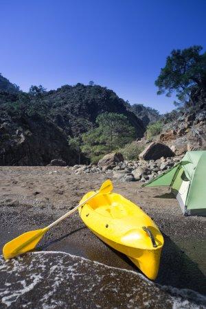 Kayak on the beach on a sunny day.