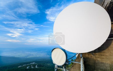 The system of telecommunication aerials high above the landscape