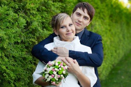 Man tenderly embraced his girlfriend