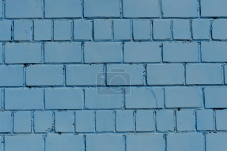 Brick wall. Wall painted in blue color. Texture