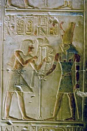 An ancient egyptian painted hieroglyphic carving s...