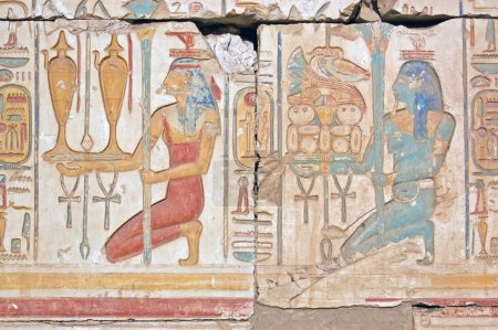 An Ancient Egyptian hieroglyphic carving showing t...