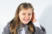 Little girl with hearing problems. Little girl trying to listen. Little girl with bad ear. Deaf child.