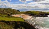Ocean cliffs and beach in sunne day