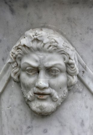 marble bas-relief in the form of ancient man face with beard on