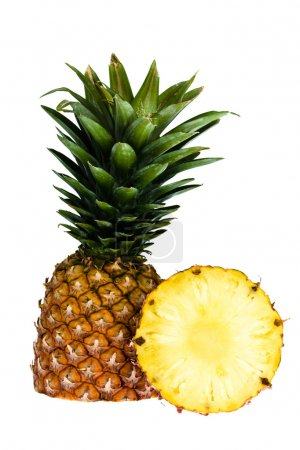 slice of ripe tasty pineapple with leaf isolated on white