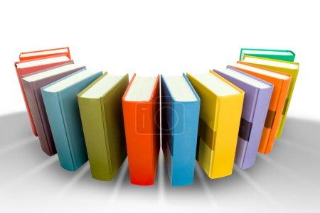 Photo pour Pile de livre coloré en hémicircle isolé sur blanc - image libre de droit