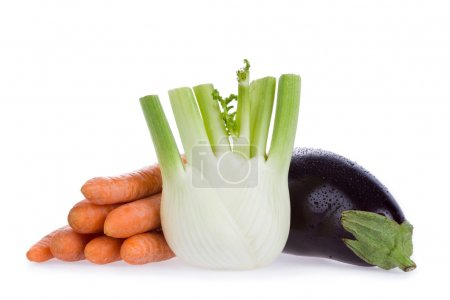 ripe healty carrots fennel eggplant isolated on white