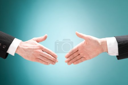 Photo for Businessman positive deal with handshake isolated on blue - Royalty Free Image
