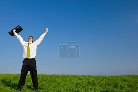 Photo for Happy businessman with suitcase outdoor in a sunny day - Royalty Free Image
