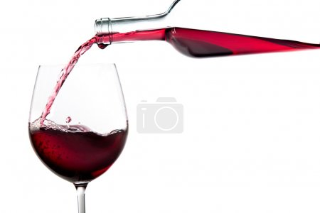 Elegant red wine bottle pour glass isolated on white