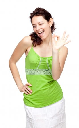 young beautiful green girl ok gesture isolated on white