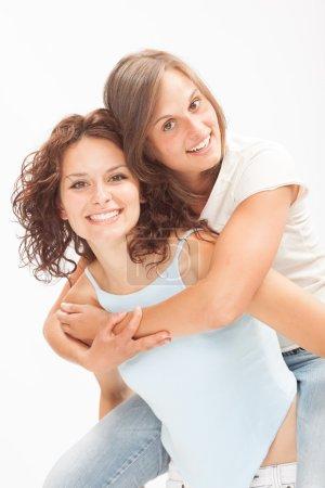 beautiful young girl couple hug smile isolated on white