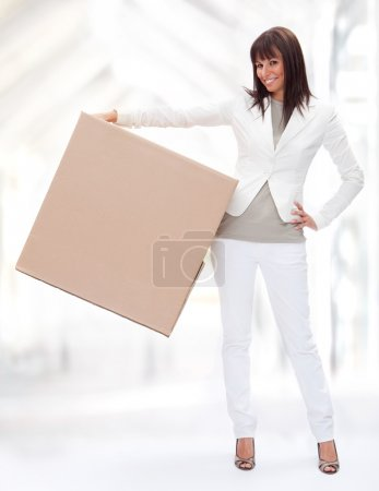 Photo for Beautiful young girl hold a box in a interior background - Royalty Free Image