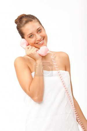 beautiful young girl with blue eyes talking phone isolated on white