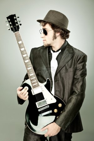 funny guitar player in concert isolated on grey