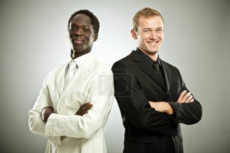 black and white businessman interracial teamwork isolated on grey