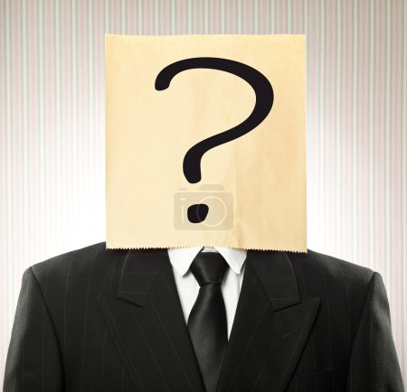 conceptual businessman with paper bag  with question mark on the head on vintage background