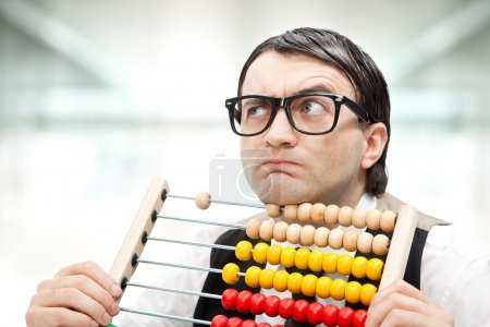 Photo for Funny nerd man with an abacus at office - Royalty Free Image