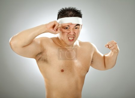 asian body builder naked show muscle on grey background