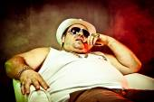 italian funny mafia boss rapper with undershirt and sunglasses on smoky background