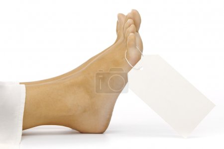 Dead body feet with card autopsy isolated on white...
