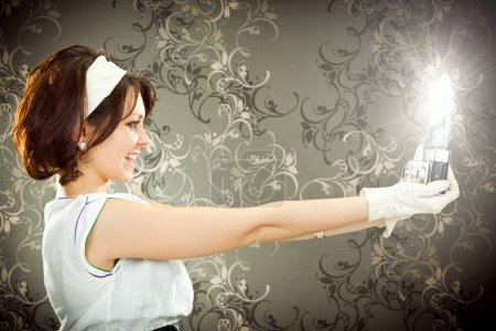 beautiful vintage girl take photograph with old camera on tapestry background