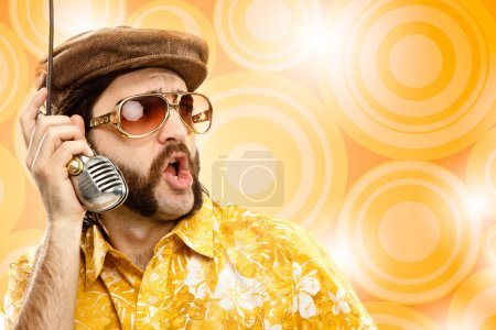 1970s vintage show man sing with hawaiian shirt and microphone on yellow background