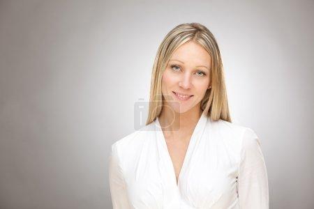 european caucasian blonde happy business woman studio portrait