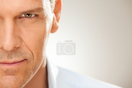 Handsome man with shirt half portrait isolated on grey