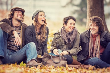 Photo for Group of Friends having fun at the park  in autumn - Royalty Free Image