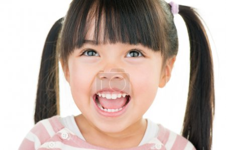 Photo for Asian smiling little girl with pigtail isolated on white - Royalty Free Image