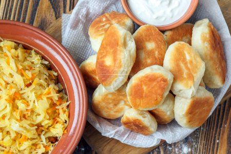 Traditional homemade pies with cabbage and sauerkr...