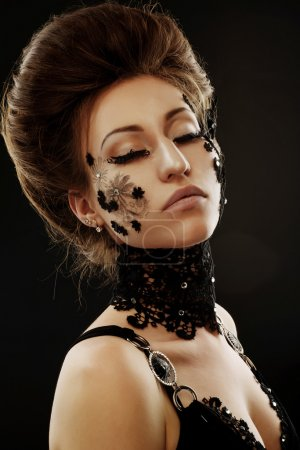 woman black lace flowers on face