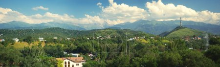 Village between green hills