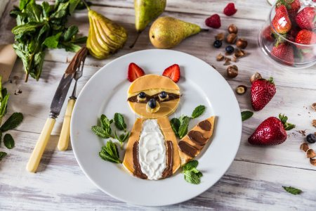 Photo for Top view on pancakes in the shape of a raccoon - Royalty Free Image