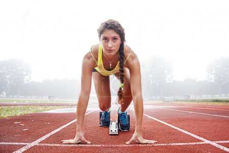 Photo for Athlete on the starting blocks - Royalty Free Image