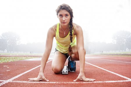 Photo for Young athlete on the starting blocks - Royalty Free Image