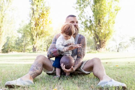 tattooed father have fun with