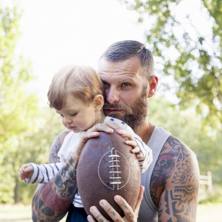 portrait of tattooed father and