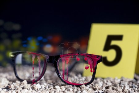 Photo for Bloody glasses at the crime scene in the night - Royalty Free Image
