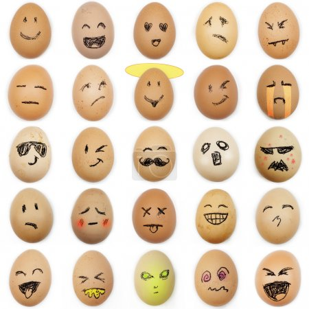 multitude of different smiley faces drawn on the eggshell on whi