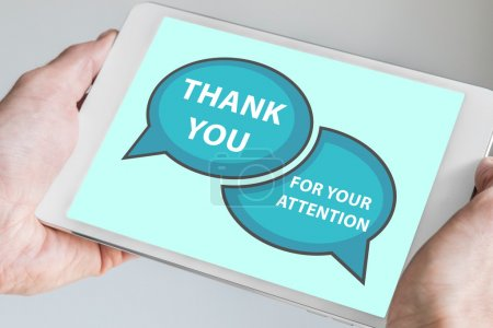Thank you for your attention concept with hand holding modern touch screen device like tablet to be used as slide background