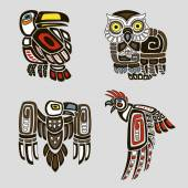 Colorful set of birds includes owl toucan eagle and parrot in hand-drawn ethnic style