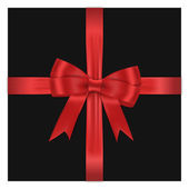 Red bow on black box against white background