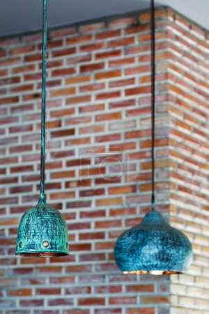 Decorative vintage chandelier on brick wall background