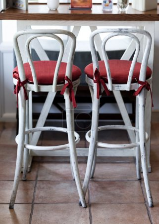 White vintage chairs with red pillow in cafe